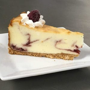 Slice of Raspberry White Chocolate Cheesecake